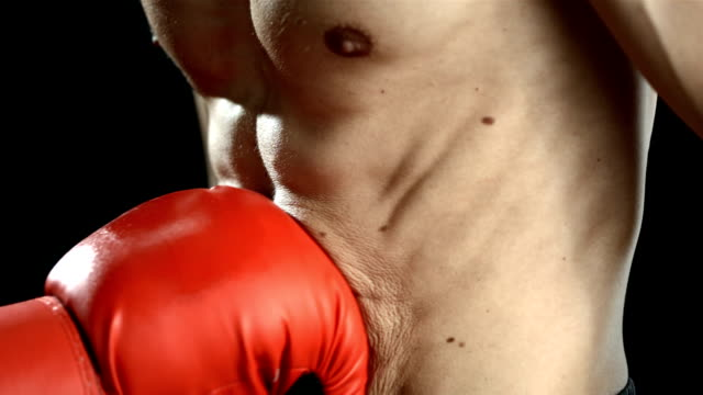 hd super slow-mo: man get punched in the stomach - stomach stock videos and b-roll footage