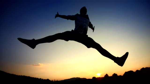 hd super slow-mo: man jumping up with positive energy - arms raised stock videos & royalty-free footage