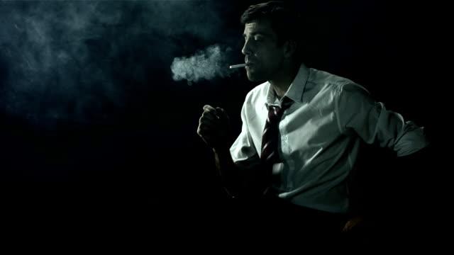 hd super slow-mo: man lights his cigarette - skjorta och slips bildbanksvideor och videomaterial från bakom kulisserna
