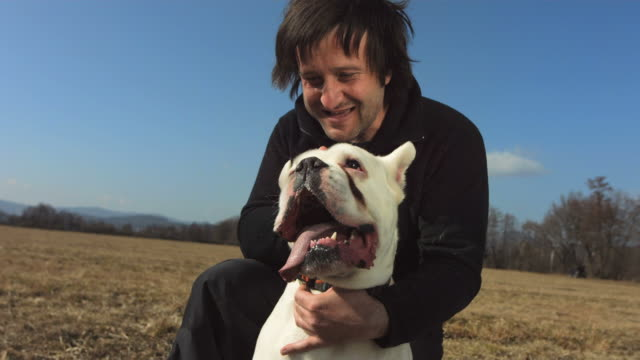 HD Super Slow-Mo: Man Playing With His Dog