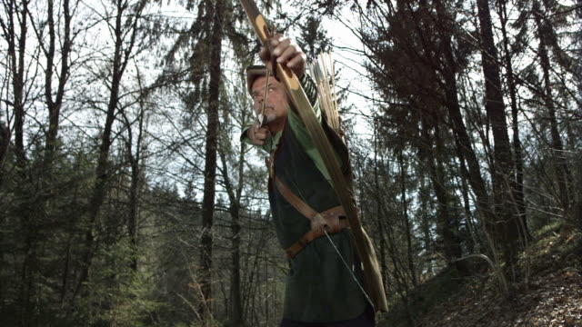hd super slow-mo: medieval archer hunting in the forest - longbow stock videos and b-roll footage