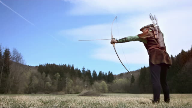 hd super slow-mo: medieval archer hunting in woodland glade - longbow stock videos and b-roll footage