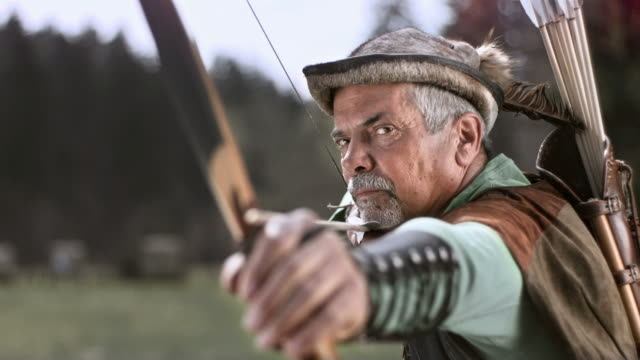 hd super slow-mo: medieval archer shoot with bow and arrow - longbow stock videos and b-roll footage