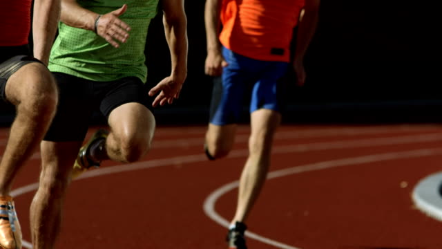 hd super slow-mo: men running on the track - contest stock videos & royalty-free footage
