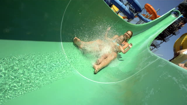 HD Super Slow-Mo: Mother And Daughter Sliding On Water Slide
