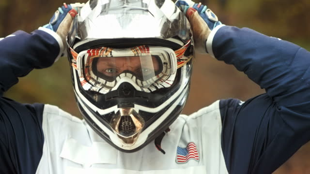 hd super slow-mo: motocross rider preparing for a ride - sports helmet stock videos & royalty-free footage