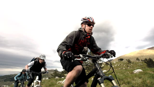 HD Super Slow-Mo: Mountain Bikers Riding On Cloudy Day
