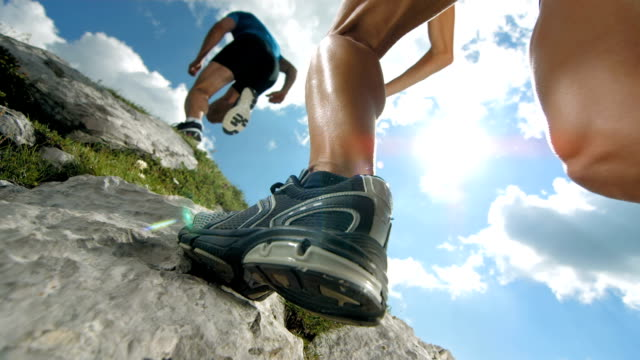 hd super slow-mo: mountain running - extreme terrain stock videos & royalty-free footage