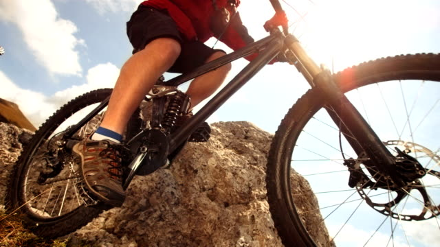 hd super slow-mo: mtb jumping on extreme mountain trail - mountain bike stock videos & royalty-free footage