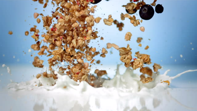 hd super slow-mo: muesli with fresh blueberries - yoghurt stock videos and b-roll footage
