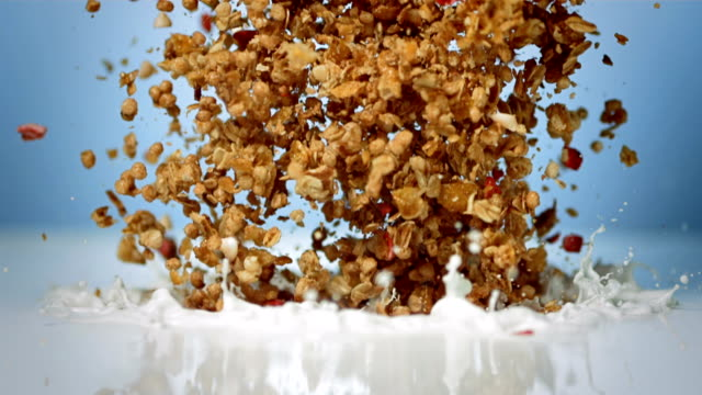 hd super slow-mo: muesli with milk - breakfast cereal stock videos and b-roll footage