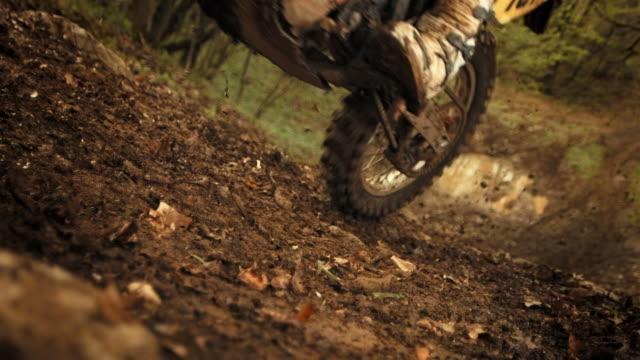 hd super slow-mo: mx rider speeding uphill - motocross stock videos & royalty-free footage