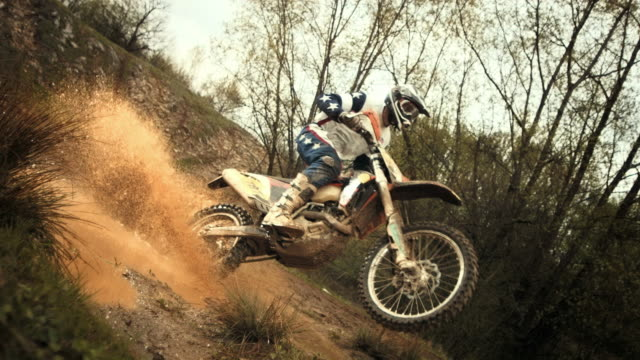 HD Super Slow-Mo: MX Rider Splashing Mud At Camera
