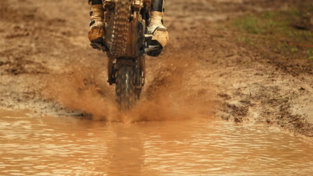 hd super slow-mo: mx rider splashing through mud - wearable camera stock videos & royalty-free footage