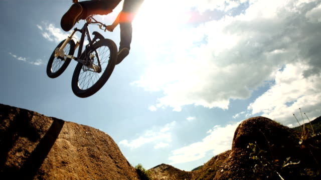 hd super slow-mo: no-footed can-can trick - freestyle bmx stock videos and b-roll footage