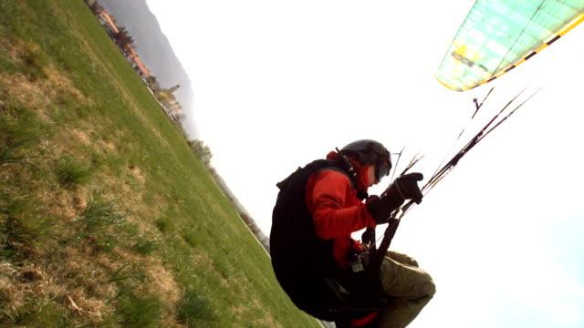 hd super slow-mo: parachutist landing - paragliding stock videos & royalty-free footage