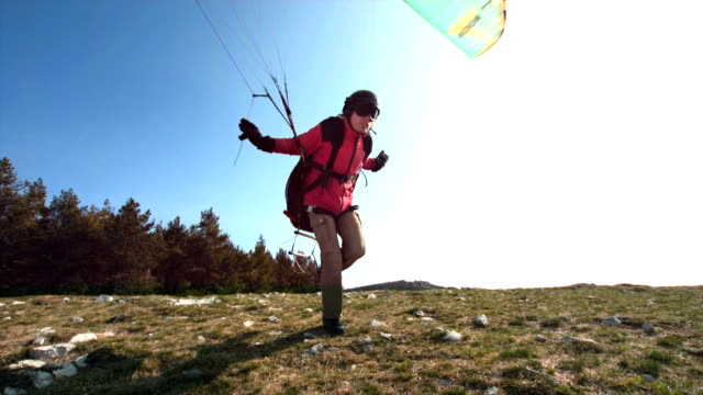 hd super slow-mo: paraglider launching off the hill - paragliding stock videos & royalty-free footage