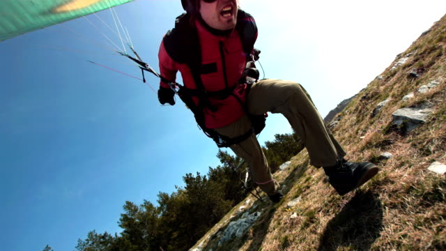 hd super slow-mo: paraglider taking off - paragliding stock videos & royalty-free footage