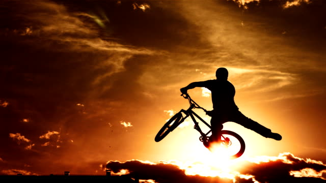 hd super slow-mo: performing tail whip at sunset - bmx cycling stock videos and b-roll footage