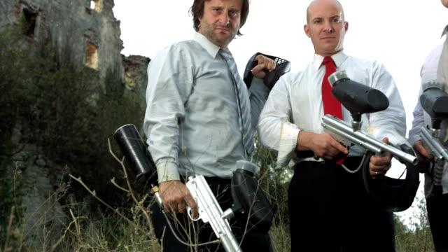 HD Super Slow-Mo: Pompous Businessmen With Guns
