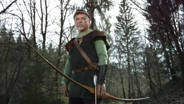 hd super slow-mo: portrait of a medieval archer - longbow stock videos and b-roll footage