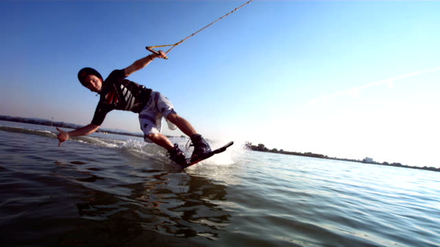 hd super slow-mo: portrait of a young wakeboarder - wakeboarding stock videos and b-roll footage