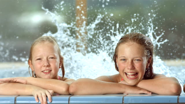 hd super slow-mo: portrait of children in the pool - brother stock videos & royalty-free footage