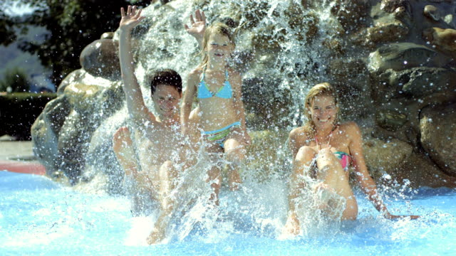 hd super slow-mo: portrait of young family splashing water - tourist resort stock videos & royalty-free footage