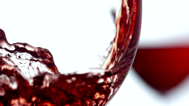 hd super slow-mo: pouring a glass of wine - wine stock videos & royalty-free footage