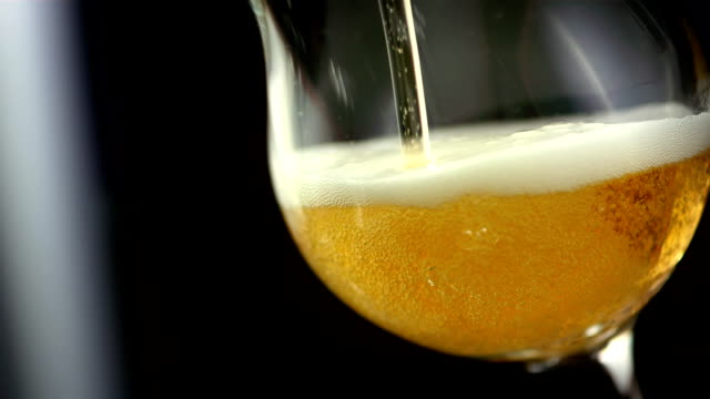 hd super slow-mo: pouring beer - pouring stock videos & royalty-free footage