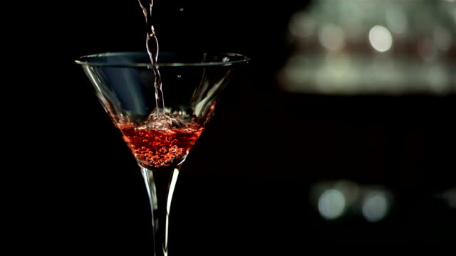 hd super slow-mo: pouring red martini - drinking stock videos and b-roll footage