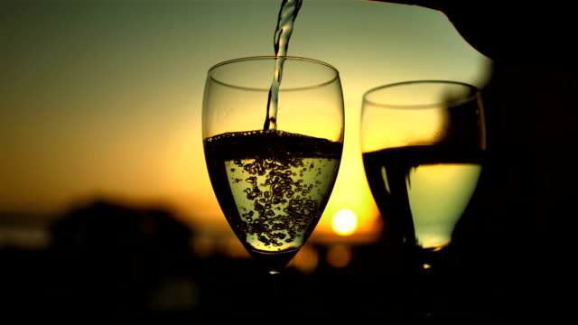 hd super slow-mo: pouring wine in the glass - champagne stock videos & royalty-free footage