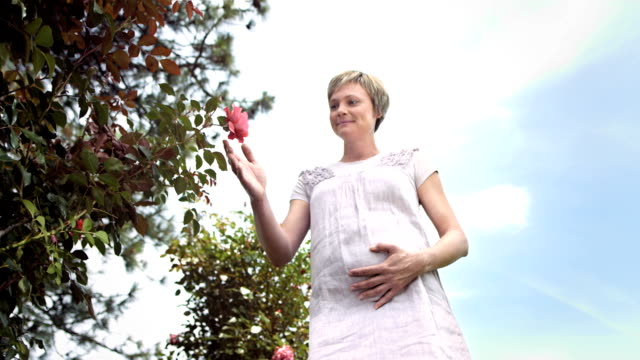 HD Super Slow-Mo: Pregnant Woman Smelling Roses