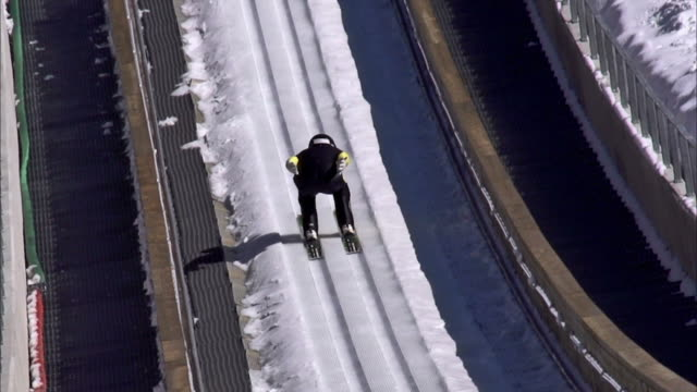 HD Super Slow-Mo: Professional Athlete Performing Ski Jump