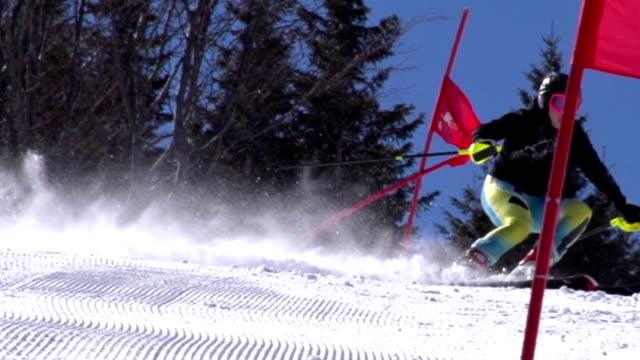 hd super slow-mo: professional female skier practicing giant slalom - slalom skiing stock videos & royalty-free footage