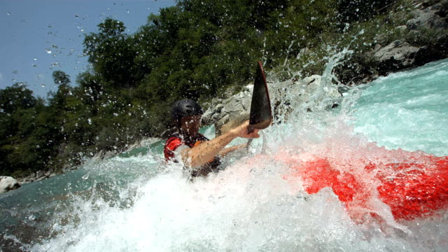 hd super slow-mo: professional whitewater kayaker in action - rapid stock videos & royalty-free footage