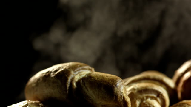hd super slow-mo: puff of steam coming from croissants - croissant stock videos & royalty-free footage