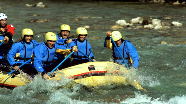 hd super slow-mo: rafters running the rapids - inflatable raft stock videos and b-roll footage