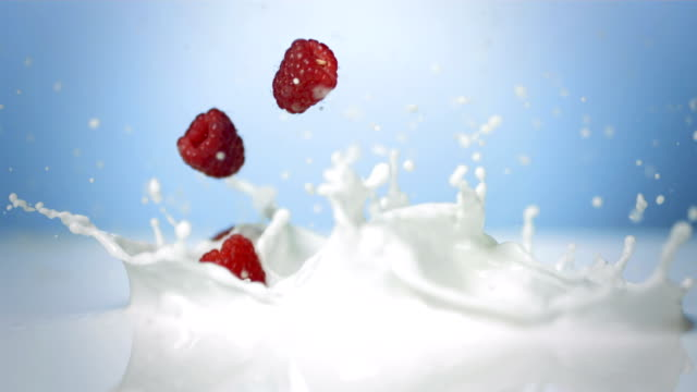 HD Super Slow-Mo: Raspberries Splashing Into Yogurt