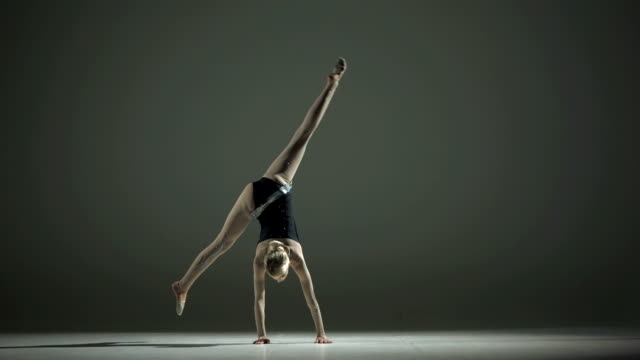 HD Super Slow-Mo: Rhythmic Gymnast Doing A Cartwheel