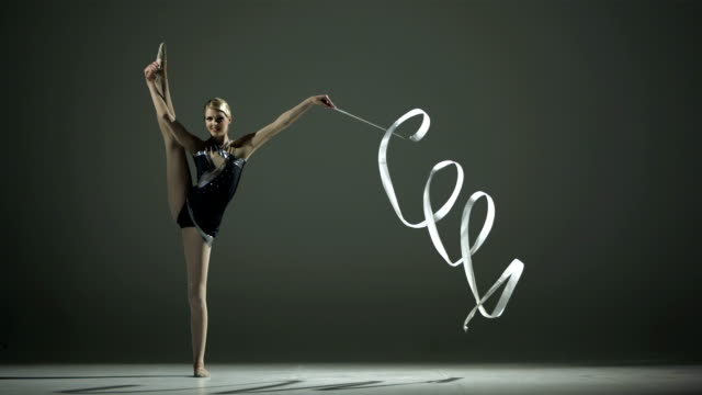 hd super slow-mo: rhythmic gymnast doing a split - gymnastics stock videos & royalty-free footage