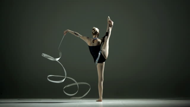HD Super Slow-Mo: Rhythmic Gymnast Twirling And Doing Split