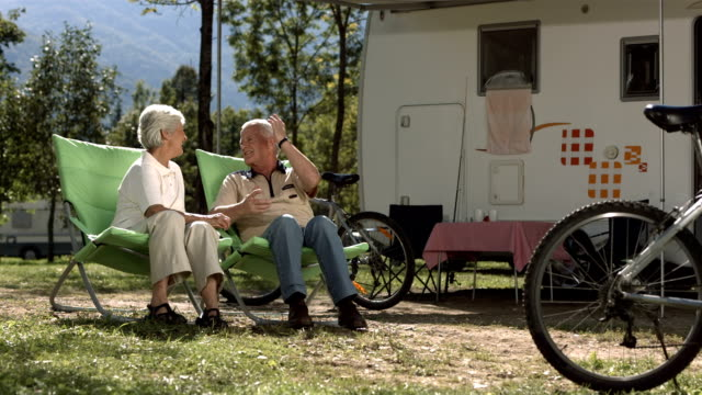 hd super slow-mo: senior couple enjoys camping - camper van stock videos and b-roll footage