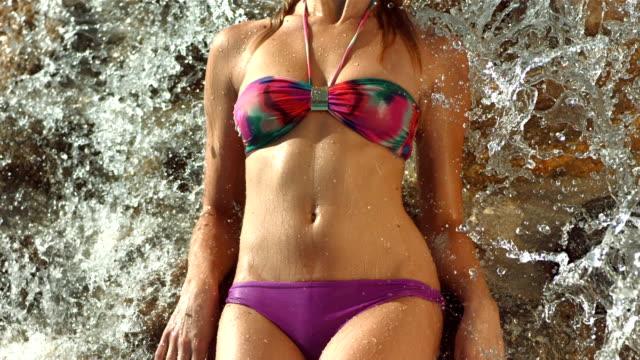 HD Super Slow-Mo: Sensual Woman Posing Under Waterfall