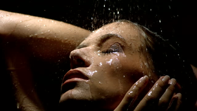 hd super slow-mo: sensual woman under the shower - wet stock videos & royalty-free footage