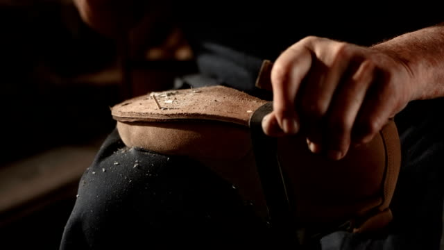 hd super slow-mo: shoemaker fastening the outsole - footwear stock videos & royalty-free footage