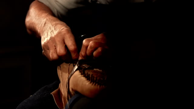 hd super slow-mo: shoemaker sewing the insole - craft stock videos & royalty-free footage