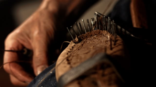hd super slow-mo: shoemaker sewing the upper to insole - craftsperson stock videos & royalty-free footage