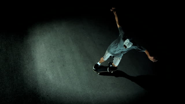 HD Super Slow-Mo: Skateboarder Doing Flip Trick
