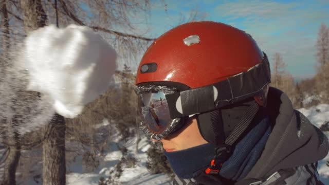 HD Super Slow-Mo: Snowball Hitting A Young Man